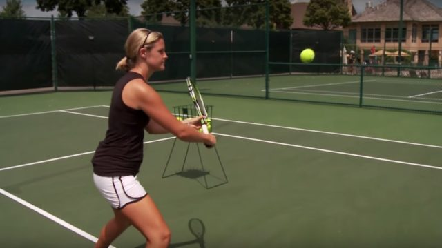 tennis player practicing volleys