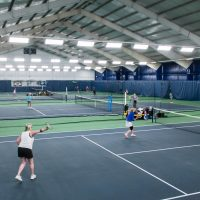 Tennis players on an indoor court