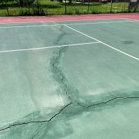 Large cracks on a tennis court