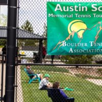 Austin Scott banner on fence at tournament