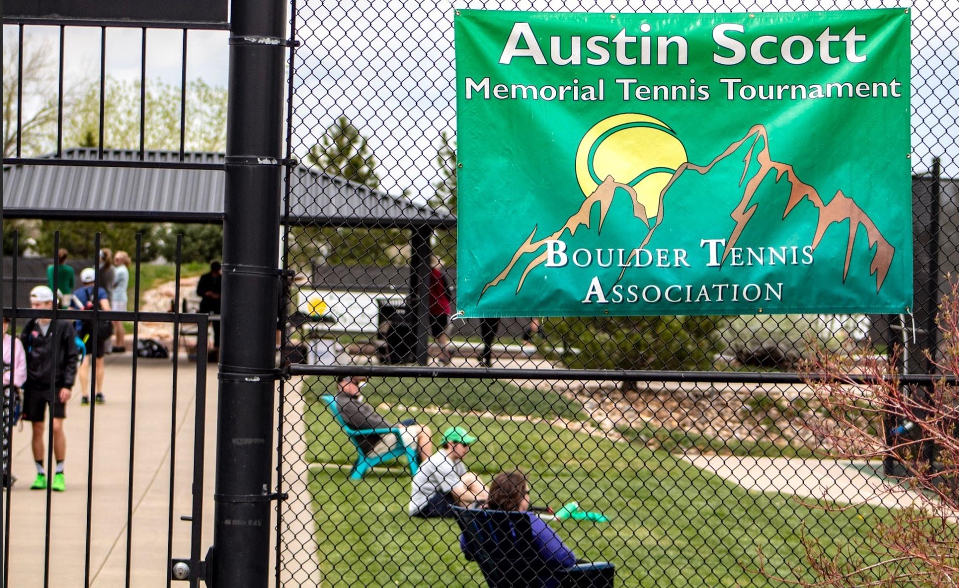 Austin Scott banner on fence at tournament