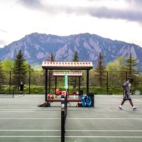 Austin Scott Tournament with Flatirons in background